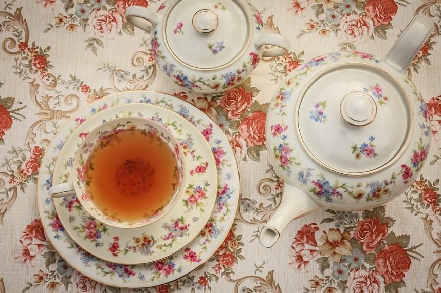 a tea set, with a tea on a tea cup